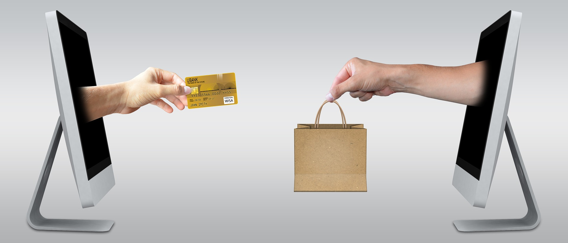 Ecommerce icons credit card and shopping bag leaping out from computer screens