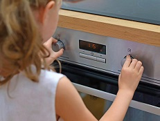 Child using a domestic appliance